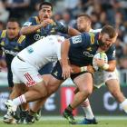 Liam Coltman takes the ball forward for the Highlanders against the Chiefs. Photo: Getty Images