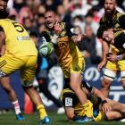 Hurricanes halfback TJ Perenara gets a pass away. Photo Getty