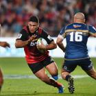 Codie Taylor on the charge for the Crusaders against the Brumbies. Photo Getty