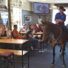 Wayne Smaill, of Outram, and his 5-year-old mare, Nah,  at the Outram Hotel yesterday. Photos:...
