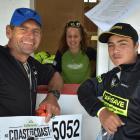Wanaka's Bob McLachlan, picks up his registration pack with Jarod Bradshaw, of Christchurch, at...
