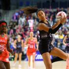 Maria Tutaia of New Zealand collects the ball ahead of Ama Agbeze of England during the Quad...