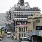 """Heritage buildings ... and dwarfed at the harbour's edge by the container terminal and its..."