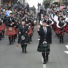 Andrew McLellan leads the pipe bands into the Octagon on Saturday from Princes St. Hundreds of ...