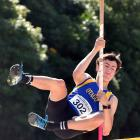 Young Dunedin athlete Cameron Miller flies over the bar in the pole vault at the Caledonian...
