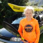 Queenstown athlete Kat Bulk loads up her kayak in Queenstown this week, on her way to compete in...