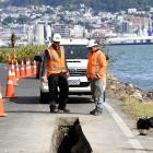 Contractors work on a new pipe to control stormwater cascading  off an Otago Peninsula property...