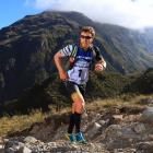 Sam Clark , of Whakatane, is high among the hills in last year's Coast to Coast event. Photo:...