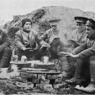 British Tommies keeping warm while awaiting their lunch of pork and beans. - Otago Witness, 14.2...