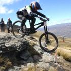 Queenstown downhill mountain biker Sam Robbie (17) hits a rock jump during his run at the...
