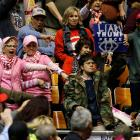 Supporters of US President Donald Trump jeer a protester who disrupted his rally at Municipal...