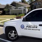 A Huntington Beach police Crime Scene Investigator vehicleoutside the family home of Denise...