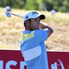 First-round leader Ben Campbell, of New Zealand, follows the flight of the ball at Millbrook on...