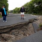 Chris and Viv Young look at quake damage along State Highway 1, south of Blenheim, following the...