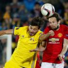 Rostov's Aleksandr Erokhin (L) in action with Manchester United's Daley Blind. Photo: Reuters