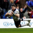 Tommy Seymour dives over to score Scotland's fourth try. Photo Reuters