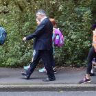 Dunedin Mayor Dave Cull walks to school with Arthur Street School pupils along Maori Rd yesterday...