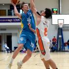 Otago's Josh Aitcheson lines up to shoot over the top of Southland Sharks defender Derone Raukawa...