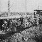 A British big gun is hauled by caterpillar tractor along a muddy road to the front in Northern...