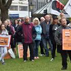 Rally attendees hold placards and listen to speeches in the Octagon this morning. PHOTO: PETER...