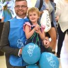 Stephen Willis holds his daughter Darcie (4), who is now in remission from a rare form of cancer,...