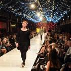 Dunedin photographer James Russell on the catwalk last night, and in his regular role as a...