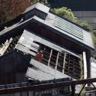 Cere Environmental NZ contractors are working to remove the asbestos roof of the former Sims...