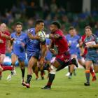 Chance Peni of the Force offloads the ball during their game against the Reds this year. Photo:...