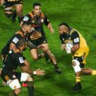Loni Uhila of the Hurricanes runs at Hika Elliot of the Chiefs during the round three Super Rugby...