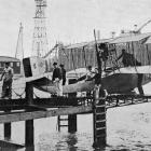 An ingenious landing stage for seaplanes at Dunkirk. The iron carriage is lowered beneath the...