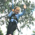 IMG 2918: 5 year old Eliza Isobell Bryant of Te Anau has time for a wave as she enjoys a ride on...