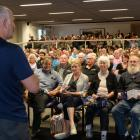 Gareth Morgan speaks to a packed audience at the Otago Museum's Hutton Theatre last night. Photo...