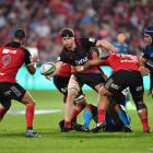 Scott Barrett gets a pass away for the Crusaders. Photo Getty