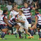 The Chiefs' Damian McKenzie tries to break through the Rebels defence. Photo Getty