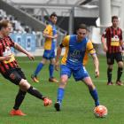 Southern United captain Harley Rodeka looks on as Canterbury United's Andreas Wilson passes the...
