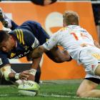 Highlanders winger Waisake Naholo shows impressive athleticism to score against the Chiefs. Photo...
