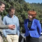 Conservation Minister Maggie Barry talks to Tussock Innovation's Jesse Teat (left) and Mark...