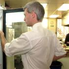 DCC inspector Tony Mole tests the temperture of a fridge in the Octagon. Photo: ODT.