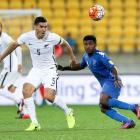 Michael Boxall of New Zealand and Setareki Hughes of Fiji compete for the ball during the All...