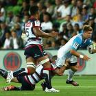 Piers Francis is tackled playing for the Blues against the Rebels earlier in the year. Photo:...
