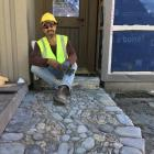 Stone mosaic artist Jeffrey Bale with an example of his work at Camp Glenorchy. PHOTO: SUPPLIED