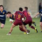 Loose forward Jamie Mowat runs the ball up for Dunedin with Caleb Young (left) and Angus Vincent...