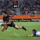 Warriors halfback Shaun Johnson gets past his Canterbury Bulldogs counterpart, Moses Mbye,...