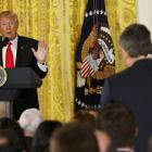 US President Donald Trump takes a question from CNN reporter Jim Acosta (right) during a news...