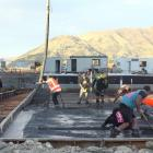 Contractors from Cook Brothers Construction pour the first concrete for the new Wanaka pool floor...