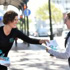 Dunedin Writers and Readers Festival chairwoman Alexandra Bligh hands a festival programme to...