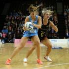 Steel wing attack Gina Crampton (left) catches the ball under pressure from Waikato-Bay of Plenty...