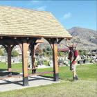 Wanaka Residents' Association President Roger Gardiner puts a last lick of paint on the new...