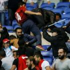 Besiktas and Lyon fans clash in the stands during the game. Photo Reuters