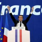 Emmanuel Macron celebrates after partial results in the first round of the French presidential...